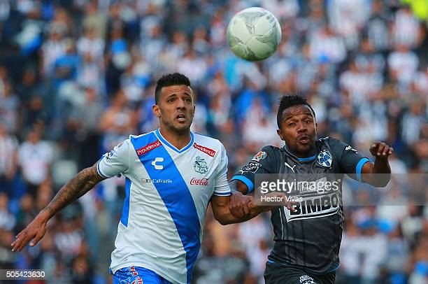Dorlan Pabon of Monterrey struggles for the ball with Robert Herrera of Puebla during the 2nd round match between Puebla and Monterrey as part of the...