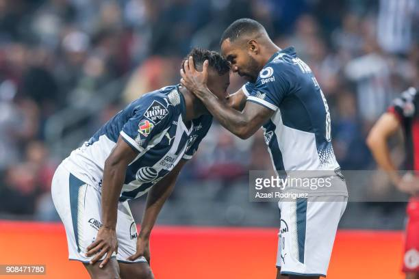 Dorlan Pabon of Monterrey talks to teammate Aviles Hurtado as he prepares to take a penalty kick during the third round match between Monterrey and...