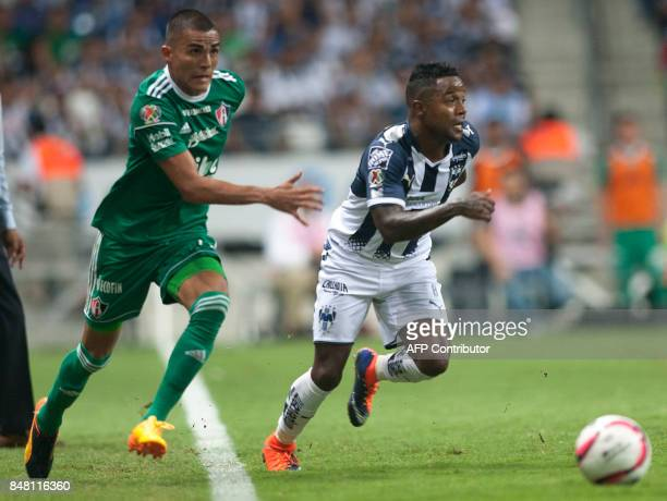 Dorlan Pabon of Monterrey vies for the ball with Luis Reyes of Atlas during their Mexican Apertura 2017 tournament football match at the BBVA...