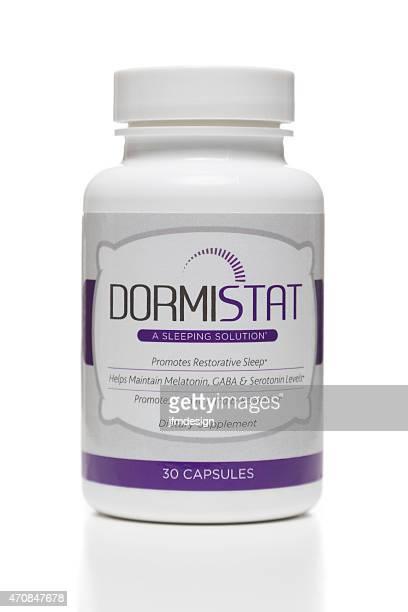 dormistat dietary supplement jar - melatonin stock photos and pictures