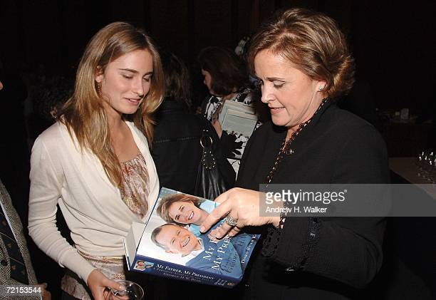 Doro Bush Koch signs a copy of her book 'My Father My President' for Lauren Bush on October 11 2006 in New York City