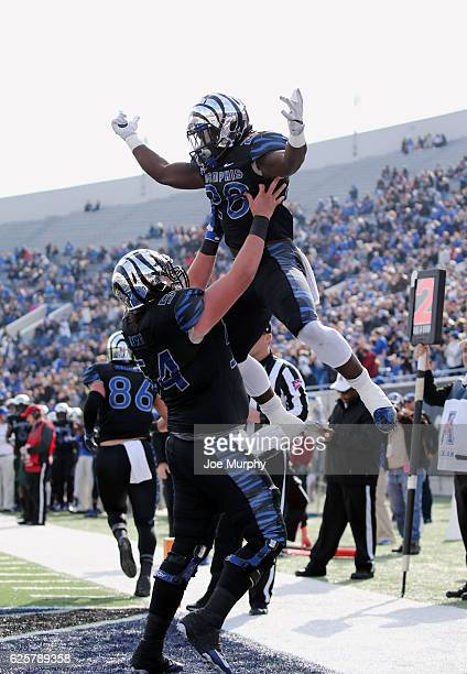 Doroland Dorceus of the Memphis Tigers celebrates his touchdown with Drew Kyser of the Memphis Tigers against the Houston Cougars on November 25,...