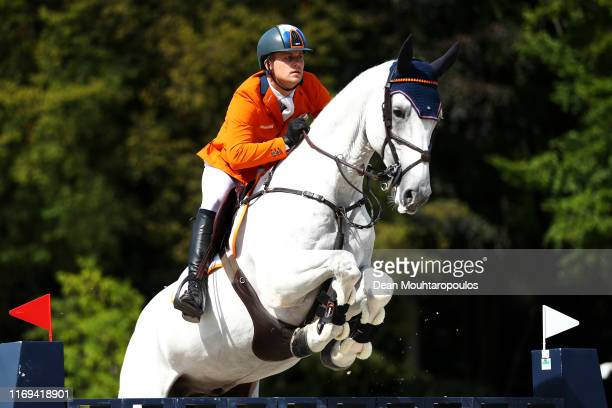 Doron Kuipers of Netherlands riding Charley competes during Day 3 of the Longines FEI Jumping European Championship speed competition against the...