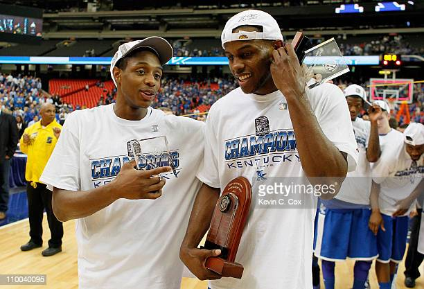 Doron Lamb and MVP Darius Miller of the Kentucky Wildcats celebrate their 70 to 54 win over the Florida Gators during the championship game of the...