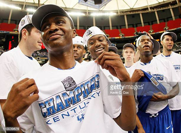 Doron Lamb of the Kentucky Wildcats celebrates with his team after they defeated the Florida Gators 70 to 54 during the championship game of the SEC...