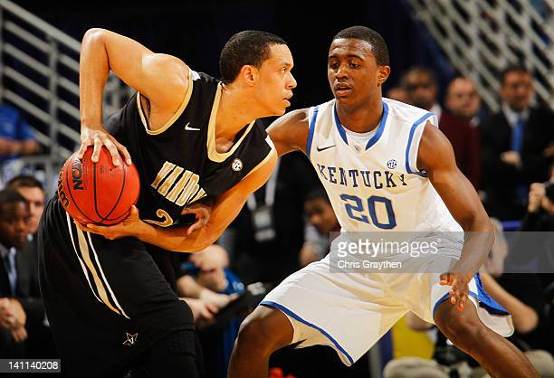 Doron Lamb of the Kentucky Wildcats defends against Kedren Johnson of the Vanderbilt Commodores during the championship game of the 2012 SEC Men's...