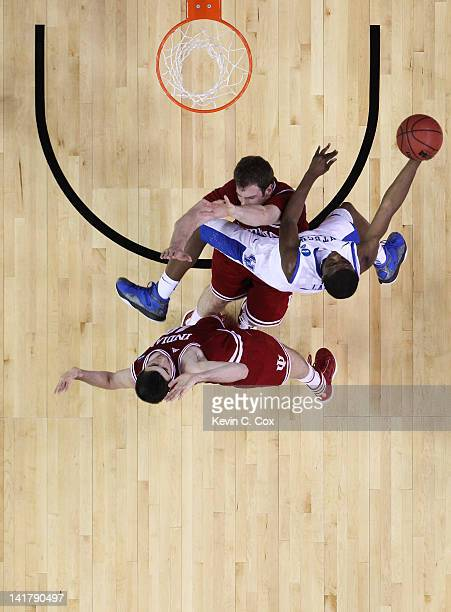 Doron Lamb of the Kentucky Wildcats goes to the basket over Cody Zeller and Will Sheehey of the Indiana Hoosiers during the 2012 NCAA Men's...