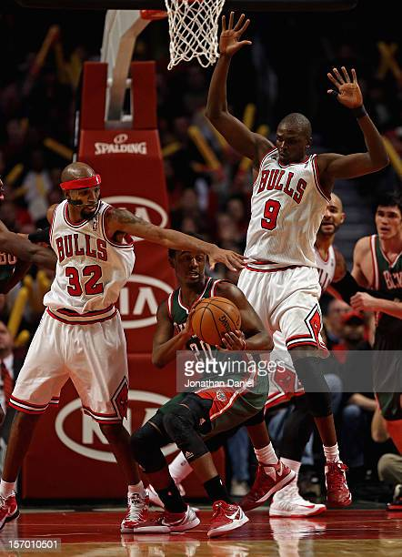 Doron Lamb of the Milwaukee Bucks is trapped by Richard Hamilton and Loul Deng of the Chicago Bulls at the United Center on November 26 2012 in...