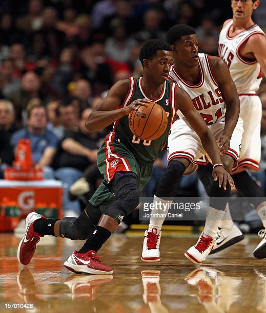 Doron Lamb of the Milwaukee Bucks moves around Jimmy Butler of the Chicago Bulls at the United Center on November 26 2012 in Chicago Illinois The...