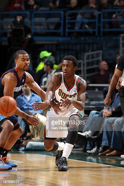 Doron Lamb of the Milwaukee Bucks passes against Ramon Sessions of the Charlotte Bobcats during the game on December 7 2012 at the BMO Harris Bradley...