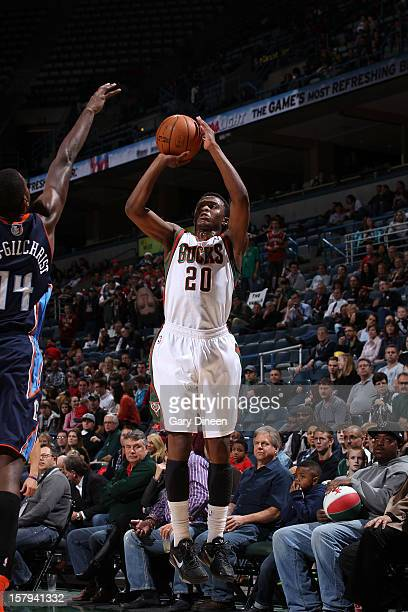 Doron Lamb of the Milwaukee Bucks shoots against Michael KiddGilchrist of the Charlotte Bobcats during the game on December 7 2012 at the BMO Harris...