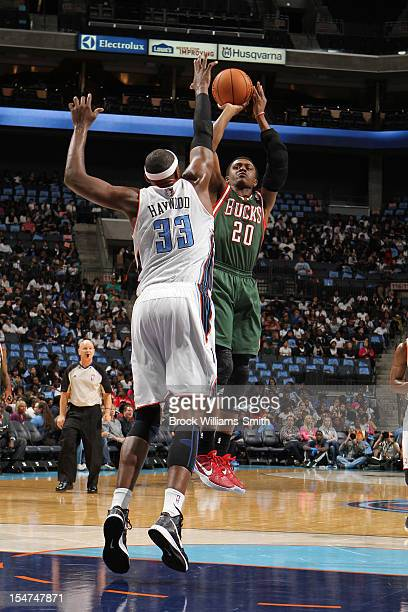 Doron Lamb of the Milwaukee Bucks shoots the ball against Brendan Haywood of the Charlotte Bobcats at the Time Warner Cable Arena on October 25 2012...