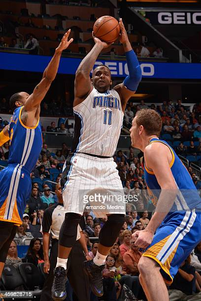 Doron Lamb of the Orlando Magic attempts a shot during a game against the Golden State Warriors on December 31 2013 at Amway Center in Orlando...