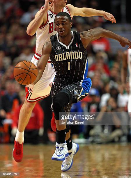 Doron Lamb of the Orlando Magic chases down a loose ball in front of Mike Dunleavy of the Chicago Bulls at the United Center on April 14 2014 in...