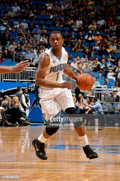 Doron Lamb of the Orlando Magic handles the ball against the Denver Nuggets on March 12 2014 at Amway Center in Orlando Florida NOTE TO USER User...