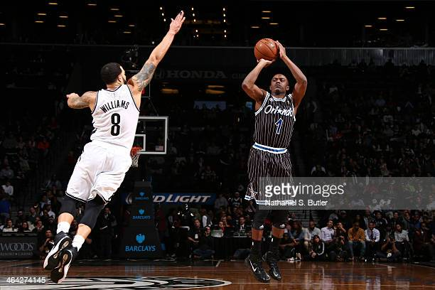 Doron Lamb of the Orlando Magic shoots against Deron Williams of the Brooklyn Nets during a game at the Barclays Center on January 21 2014 in the...