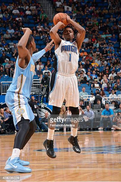 Doron Lamb of the Orlando Magic shoots against the Denver Nuggets on March 12 2014 at Amway Center in Orlando Florida NOTE TO USER User expressly...