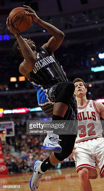 Doron Lamb of the Orlando Magic shoots past Jimmer Fredette of the Chicago Bulls at the United Center on April 14 2014 in Chicago Illinois NOTE TO...