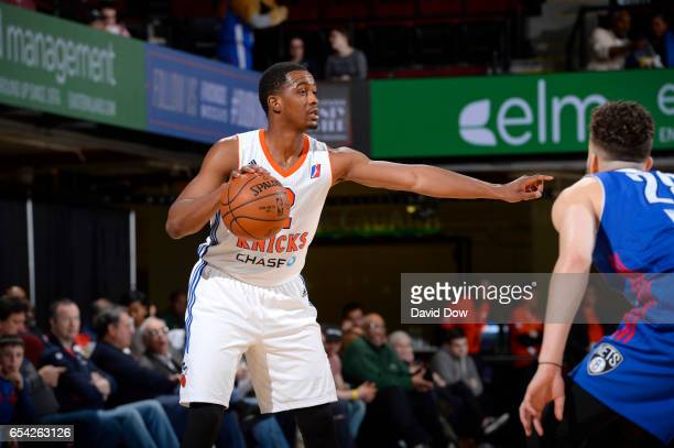 Doron Lamb of the Westchester Knicks dribbles against Akil Mitchell of the Long Island Nets at the Westchester County Center on March 16 2017 in...