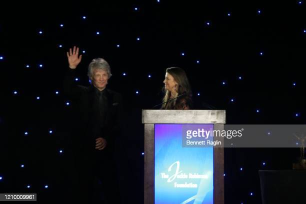 Dorothea Hurley and Jon Bon Jovi accept their Humanitarian Award during Jackie Robinson Foundation Robie Awards Dinner at Marriot Marquis on March 02...