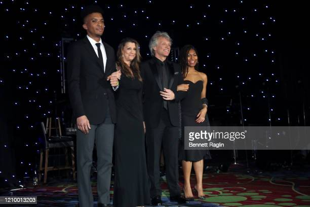 Dorothea Hurley and Jon Bon Jovi celebrate their Humanitarian Award with students Miles Esters and Chelsea Maddred during Jackie Robinson Foundation...