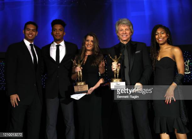 Dorothea Hurley and Jon Bon Jovi celebrate their Humanitarian Award with presenter Nicholas Tabb and students Miles Esters and Chelsea Maddred during...