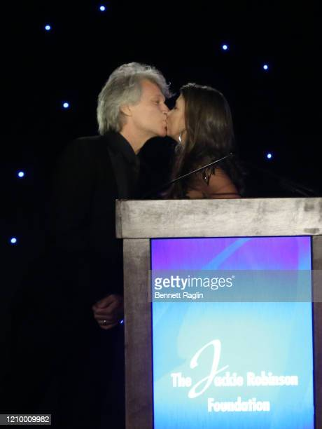 Dorothea Hurley and Jon Bon Jovi kiss as they celebrate accepting their Humanitarian Award during Jackie Robinson Foundation Robie Awards Dinner at...