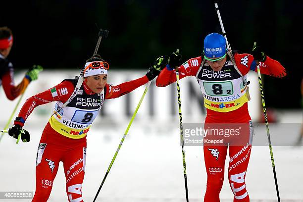 Dorothea Wierer and Lukas Hofer of Italy during a change of the WTC mass start race of the REINPOWER Biathlon World Team Challenge 2014 at...