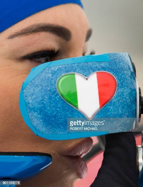 Dorothea Wierer of Italy adjusts her sight at the shooting range during the warm up prior to the women's 75 km sprint event of the IBU Biathlon World...