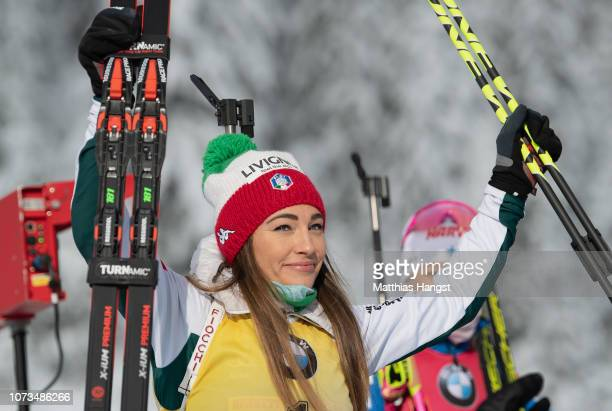 Dorothea Wierer of Italy celebrates her bronze medal on the podium during in the IBU Biathlon World Cup Women's 10 km Pursuit on December 15 2018 in...