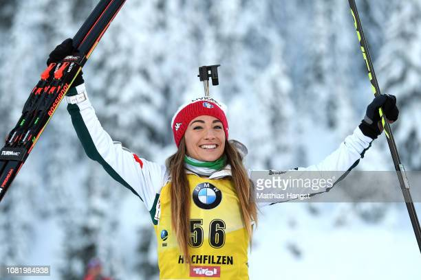 Dorothea Wierer of Italy celebrates her gold medal on the podium during the 75 km Women's Sprint at the IBU Biathlon World Cup on December 13 2018 in...