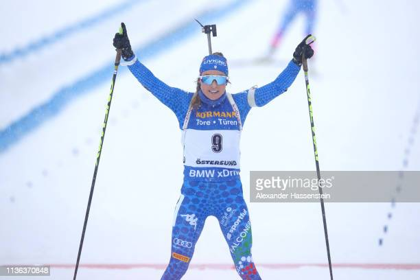 Dorothea Wierer of Italy celebrates victory in the Women's Mass Start at the IBU Biathlon World Championships on March 17 2019 in Ostersund Sweden