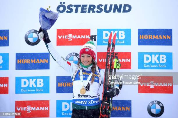 Dorothea Wierer of Italy celebrates victory on the podium following the Women's Mass Start at the IBU Biathlon World Championships on March 17 2019...