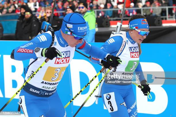Dorothea Wierer of Italy hands over to her team mate Lukas Hofer during the Mixed Relay at the IBU World Championships Biathlon AntholzAnterselva on...