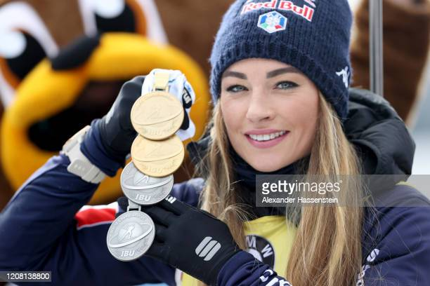 Dorothea Wierer of Italy poses with her 2 Gold medals and 2 Silver medals after the Women 125 km Mass Start Competition at the IBU World...