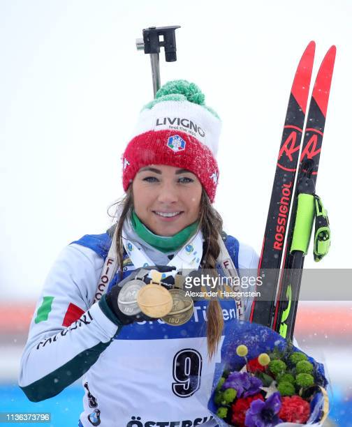 Dorothea Wierer of Italy poses with her medals from the Championships following the Women's Mass Start at the IBU Biathlon World Championships on...