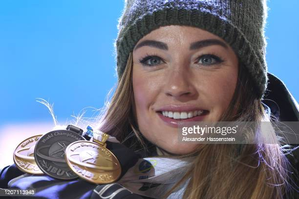 Dorothea Wierer of Italy poses with her the two gold medals and her silver medal after the medal ceremony for the Women 15 km Individual Competition...