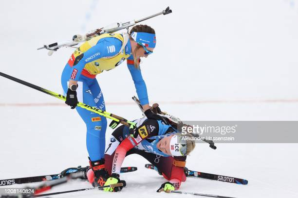 Dorothea Wierer of Italy reacts to Marte Olsbu Roeiseland of Norway after the Women 12.5 km Mass Start Competition at the IBU World Championships...