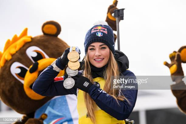 Dorothea Wierer of Italy with two gold and two silver medals during the Women 12.5 km Mass Start Competition at the IBU World Championships Biathlon...