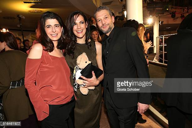 Dorothee Schumacher and Bettina Zimmermann and her partner Kai Wiesinger during the 'Vogue loves Breuninger' fashion event on March 18 2016 in...