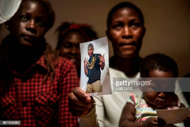 Dorothy Achieng 25yearold shows a picture of her husband Paul Omina on October 28 posing with her one year old daughter Eletra Maya Omina and her...