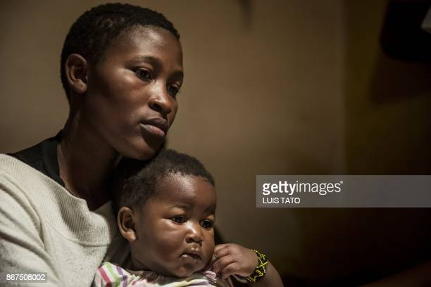 Dorothy Achieng 25yearold wife of Paul Omina is pictured on October 28 posing with her one year old daughter Eletra Maya Omina at their home in the...
