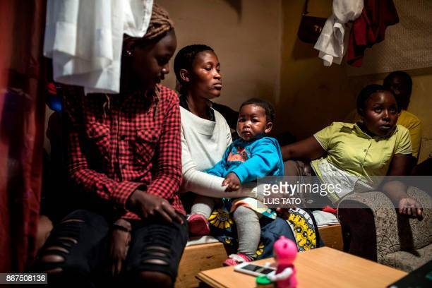 Dorothy Achieng 25yearold wife of Paul Omina is pictured on October 28 posing with her one year old daughter Eletra Maya Omina and her family members...