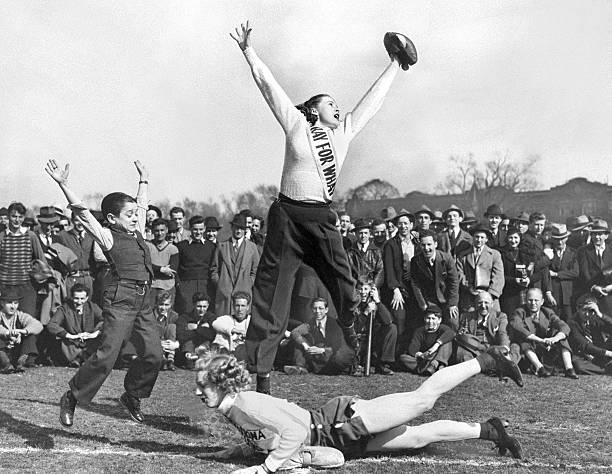 Dorothy Bird jumps for the ball as the umpire, known as Prin