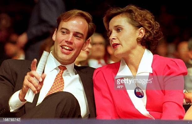 Dorothy Bush Koch the daughter of US President George Bush listens to her husband Bobby Koch 17 August 1992 during the first evening session of the...