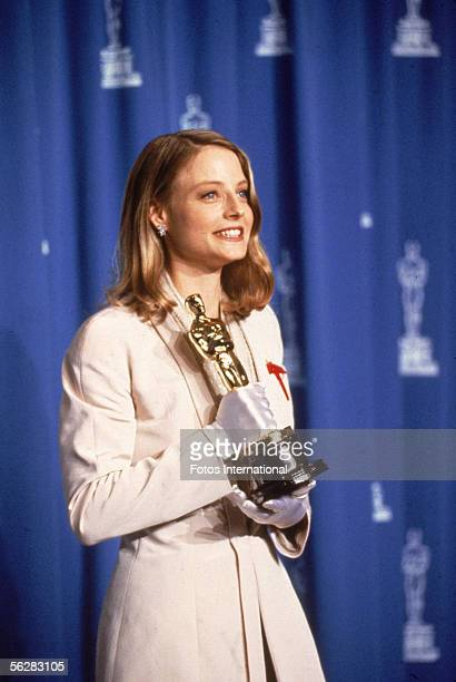 Dorothy Chandler Pavilion, Los Angeles, California American actress Jodie Foster poses backstage with her 'Oscar' award for Best Actress in a Leading...