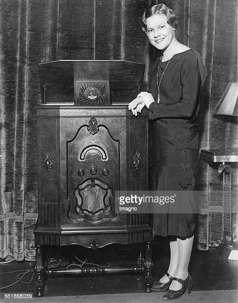 Dorothy Collier with a new radio model Presentation at the Rudolph Wurlitzer Company About 1930 Photograph