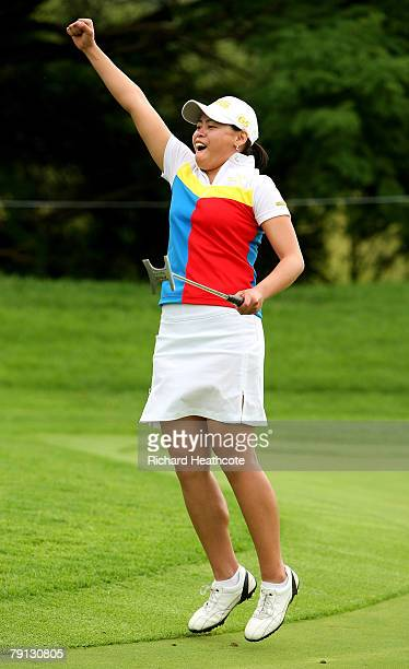 Dorothy Delasin of The Philippines celebrates holing a birdie putt on the 17th green during the final round of the Women's World Cup of Golf at The...