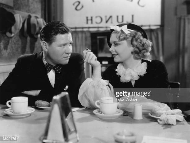 Dorothy Dell and Jack Oakie share a scene in the film 'Shoot The Works' where a bandleader and a journalist stage a fake feud The film was directed...
