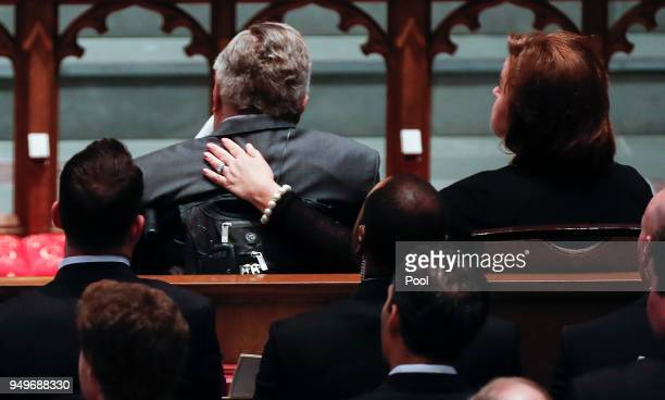 Dorothy 'Doro' Bush Koch puts her arm around the shoulder of her father former President George HW Bush during the funeral for former first lady...